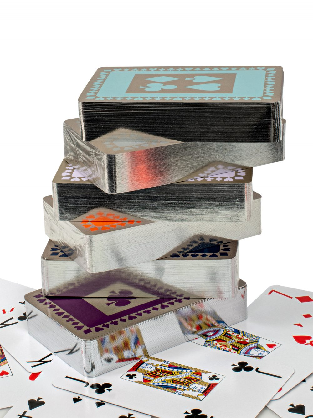 Stack of silver gilt playing cards packs