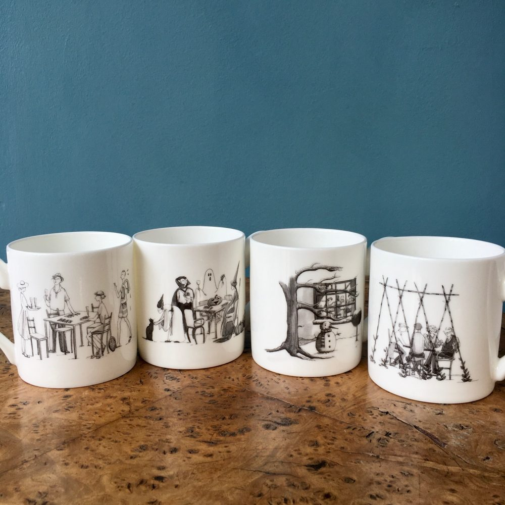 4 bone china mugs showing one side of the illustrations of the seasons on each mug