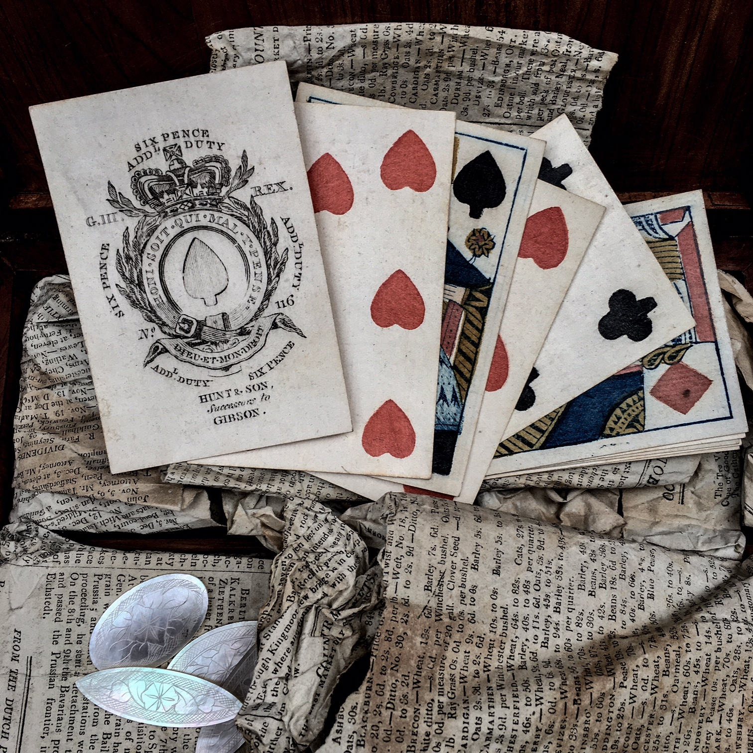 Spread of George III playing cards, showing tax paid of sixpence on the Ace of Spades.