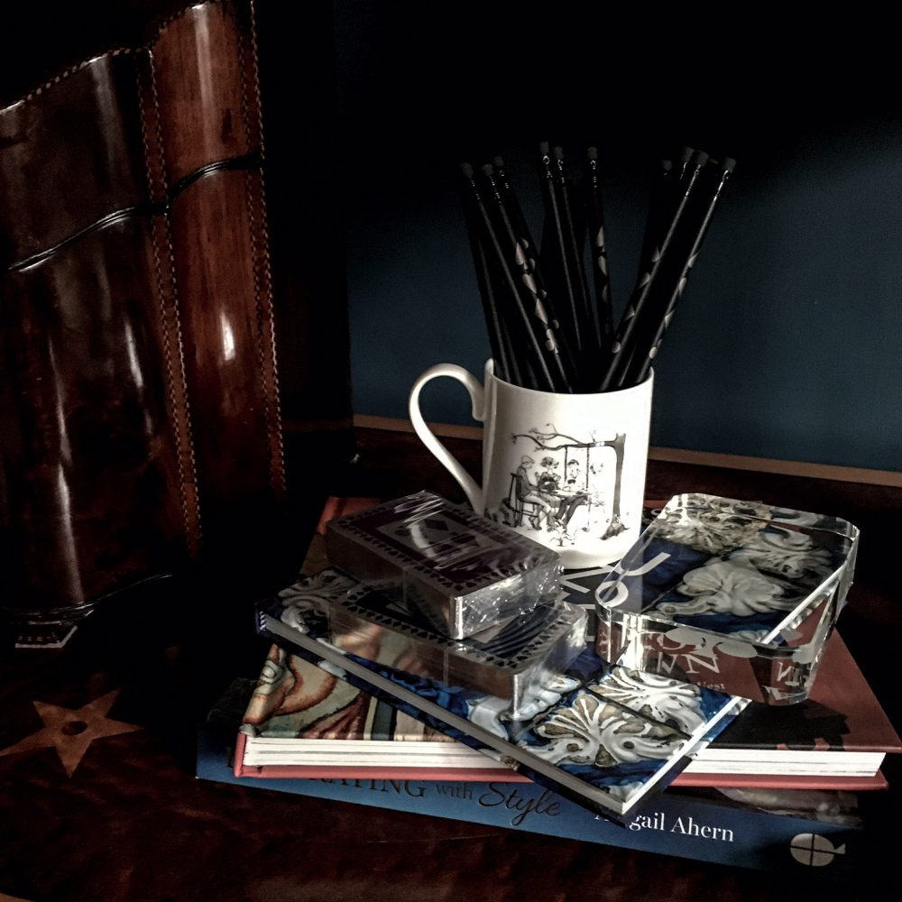 Navy and purple silver gilt playing cards with bone china mug filled with pencils for bridge scoring