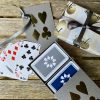 Grey sleeve box, silver card suit design on lid, containing twin pack of luxury playing cards in grey and navy