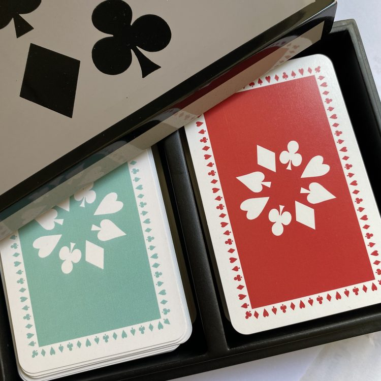 lacquered bamboo box containing twin pack of playing cards in jade and red
