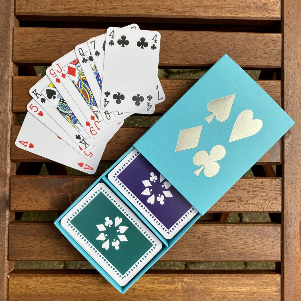 Turquoise box with purple/green cards