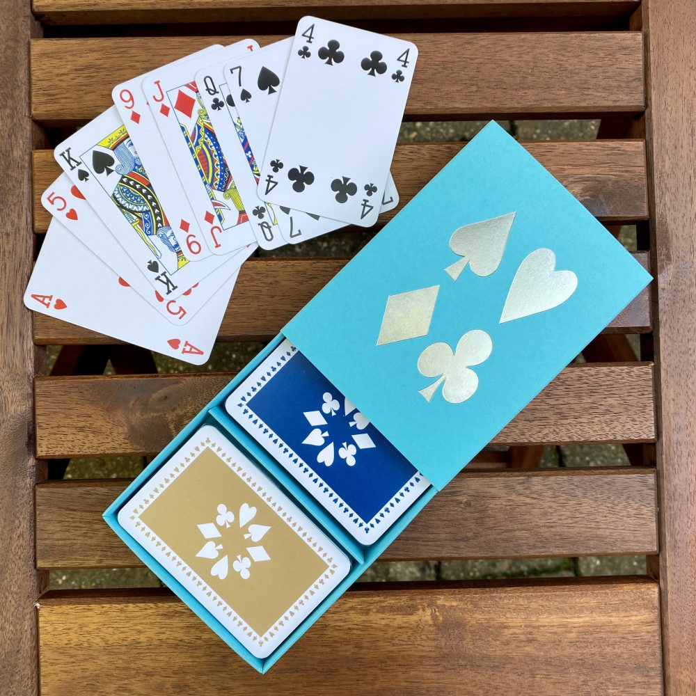 turquoise box with blue & tan cards